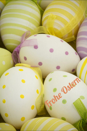 Ostern: frohe ostern against easter eggs nestled together
