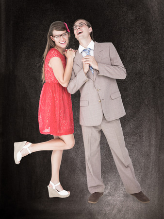 together with long tie: Hipster couple having fun together  against black background Stock Photo