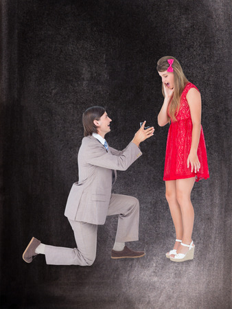 bended: Hipster on bended knee doing a marriage proposal to his girlfriend  against black background