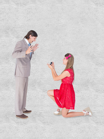 bended: Pretty hipster on bended knee doing a marriage proposal to her boyfriend against white background