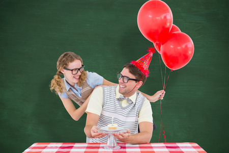 table skirt: Geeky hipster couple celebrating his birthday  against green chalkboard
