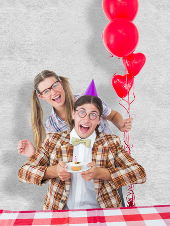 Geeky hipsters celebrating birthday  against white background