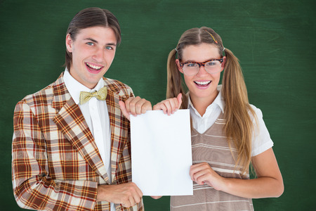 together with long tie: Geeky hipsters holding a poster  against green chalkboard