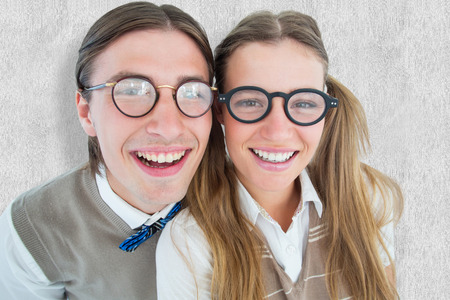 cheesy grin: Geeky hipsters smiling at camera  against white background