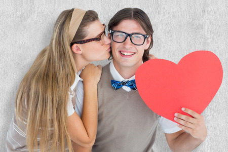 together with long tie: Smiling geeky hipster and his girlfriend  against white background