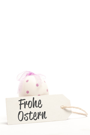frohe: frohe ostern against blank tag in front of easter egg