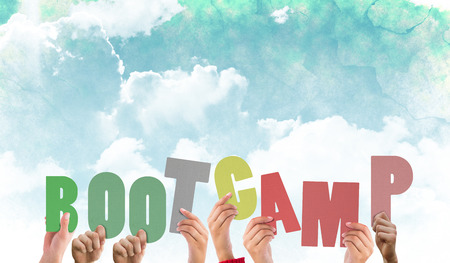 boot camp: Hands holding up boot camp against green and blue sky