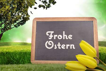 frohe: Yellow tulips against frohe ostern Stock Photo
