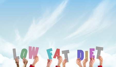 low fat diet: Hands holding up low fat diet against blue sky Stock Photo