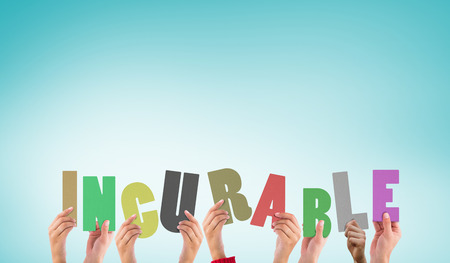 incurable: Hands holding up incurable against blue vignette background Stock Photo