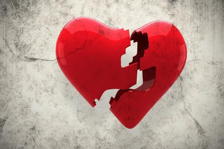 corazon roto: Coraz�n roto contra el fondo gris