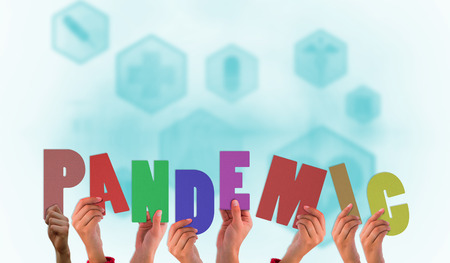 pandemic: Hands holding up pandemic against blue medical interface with icons