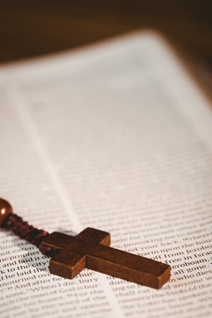 jehovah: Close up of open bible with rosary beads