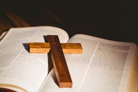 brethren: Open bible with crucifix icon on wooden table