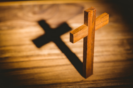 methodist: Overhead of crucifix icon on wooden table Stock Photo