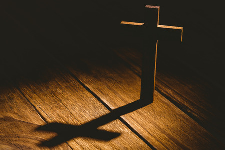 jehovah: Crucifix icon on wooden table in the shadow Stock Photo