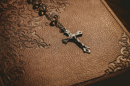 brethren: Rosary beads with bible in the shadow