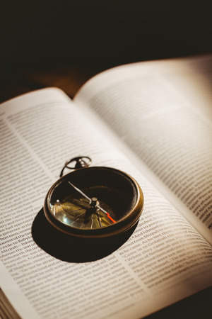 brethren: Compass on open bible in the shadow