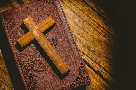 jehovah: Crucifix icon on the bible on wooden table Stock Photo