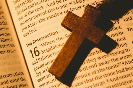 jehovah: Open bible and wooden cross overhead shot