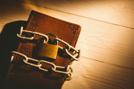 brethren: Open bible chained with lock on wooden table