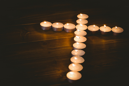 brethren: Candles in shape of cross on wooden table