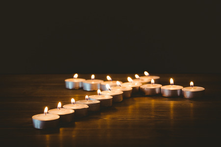 methodist: Candles in shape of cross on wooden table