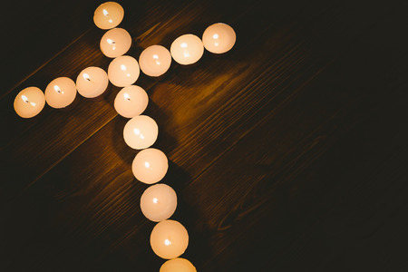 jehovah: Candles in shape of cross on wooden table