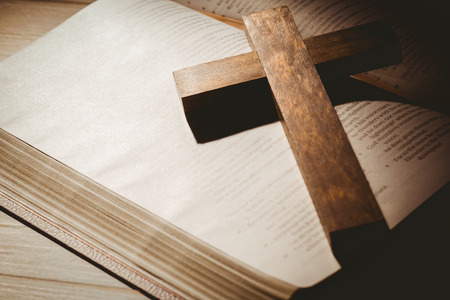 brethren: Open bible and wooden cross on wooden table