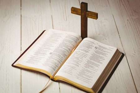 jehovah: Open bible and wooden cross on wooden table