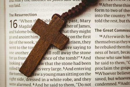 brethren: Open bible and wooden cross overhead shot