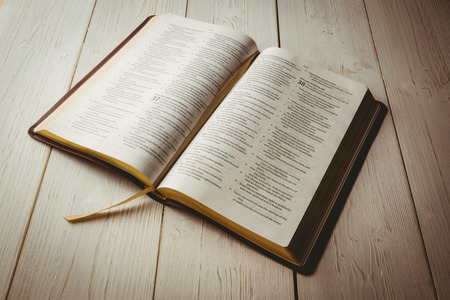 jehovah: Open bible on wooden table