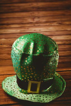 irish culture: St patricks day hat on wooden table Stock Photo