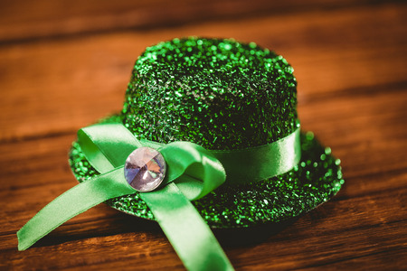 st  patty: St patricks day hat on wooden table Stock Photo