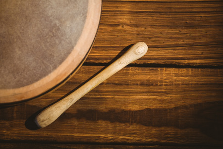animal st  patricks day: Traditional Irish bodhran and stick on wooden table Stock Photo