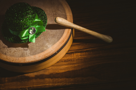 irish culture: Traditional Irish bodhran and stick on wooden table Stock Photo
