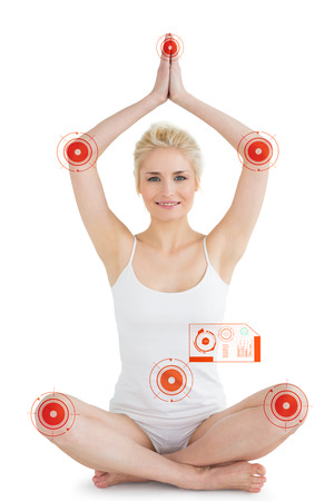 joined hands: Toned young woman sitting with joined hands over head against fitness interface