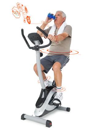 stationary bike: Senior man drinking water on stationary bike against fitness interface Stock Photo