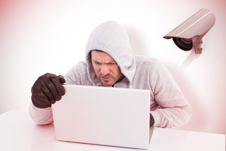 to steal: Hacker using laptop to steal identity against cctv camera