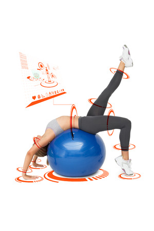 fitness ball: Fit young woman stretching on fitness ball against fitness interface