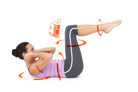 crunches: Side view of a fit young woman doing crunches against fitness interface