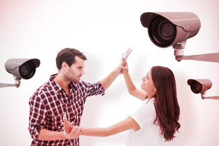 overpowered: Fearful brunette being overpowered by boyfriend against cctv camera