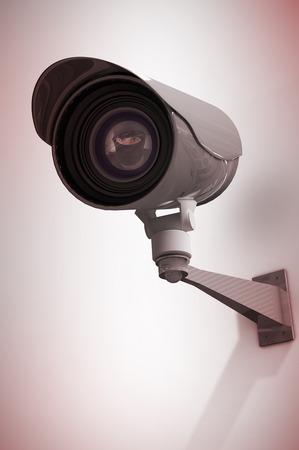 Portrait of burglar wearing a balaclava against cctv camera