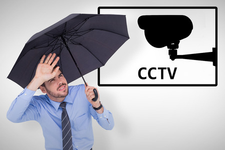 dazzled: Blinded businessman protecting his eyes with his hand against cctv