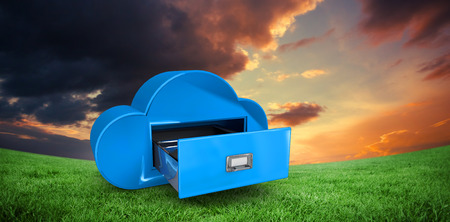 green computing: Cloud computing drawer against green field under orange sky