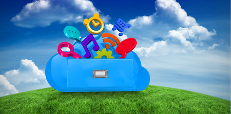 green computing: Cloud computing drawer against green field under blue sky Stock Photo