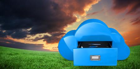 Cloud computing drawer against green field under orange sky photo