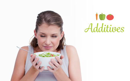 additives: The word additives against woman smelling a salad