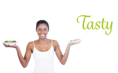 healthily: The word tasty against happy woman deciding to eat healthily or not