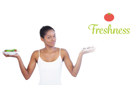 healthily: The word freshness against pretty woman deciding to eat healthily or not
